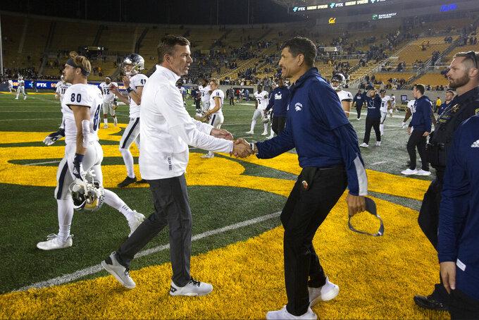 California head coach Justin Wilcox, left, greets Nevada head coach Jay Norvell following an NCAA college football game, Saturday, Sept. 4, 2021, in Berkeley, Calif. Nevada won 22-17. (AP Photo/D. Ross Cameron)