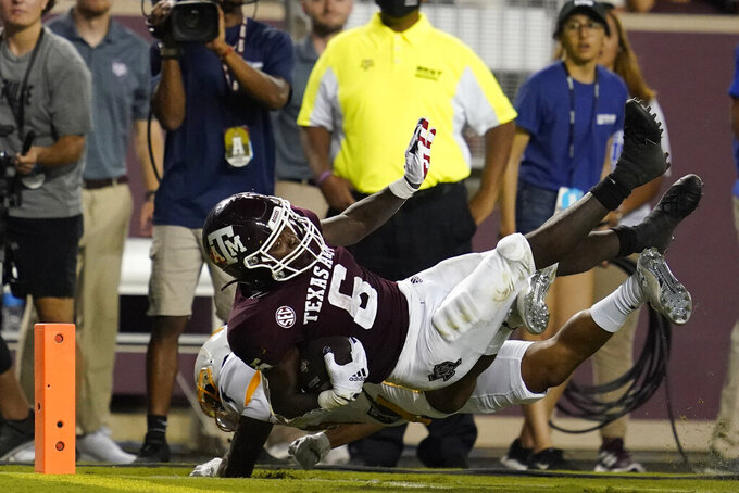 Texas A&M running back Devon Achane (6) is stopped short of the goal line by Kent State defensive back Heskin Smith (27) during the second half of an NCAA college football game on Saturday, Sept. 4, 2021, in College Station, Texas. (AP Photo/Sam Craft)
