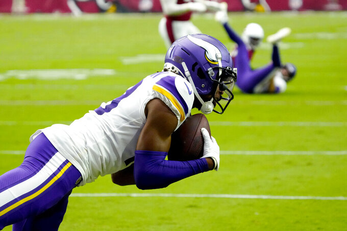 Minnesota Vikings wide receiver Justin Jefferson (18) pulls in a touchdown against the Arizona Cardinals during the first half of an NFL football game, Sunday, Sept. 19, 2021, in Glendale, Ariz. (AP Photo/Rick Scuteri)