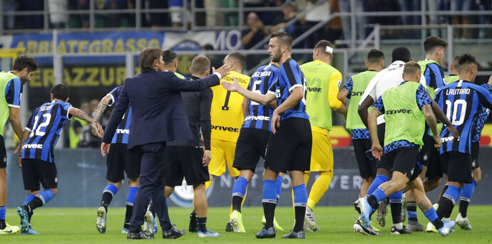 Inter Milan's head coach Antonio Conte cheers Stefan de Vrij at the end of a Serie A soccer match between Inter Milan and Udinese, at the San Siro stadium in Milan, Italy, Saturday, Sept. 14, 2019. Inter won 1-0. (AP Photo/Luca Bruno)