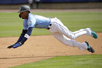 Seattle Mariners' Dee Gordon dives to steal second during the first inning of a spring training baseball game against the Oakland Athletics, Friday, Feb. 22, 2019, in Peoria, Ariz. (AP Photo/Charlie Riedel)