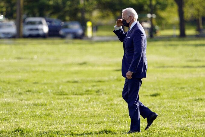 President Joe Biden walks to board Marine One on the Ellipse Friday, April 16, 2021, in Washington. (AP Photo/Andrew Harnik)
