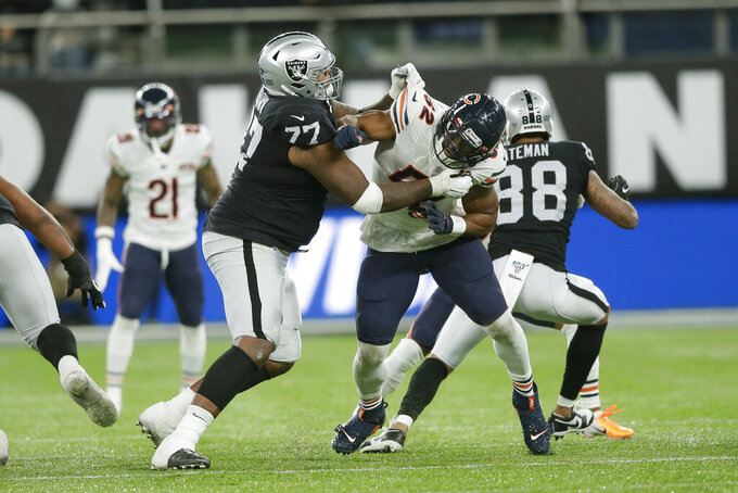 FILE - In this Oct. 6, 2019, file photo, Oakland Raiders offensive tackle Trent Brown (77) blocks Chicago Bears outside linebacker Khalil Mack (52) during the second half of an NFL football game at Tottenham Hotspur Stadium in London. From the season-altering (Dak Prescott, Saquon Barkley) to the bizarre (Tyrod Taylor, Brown), injuries are playing their traditionally significant role in the NFL. (AP Photo/Tim Ireland, File)