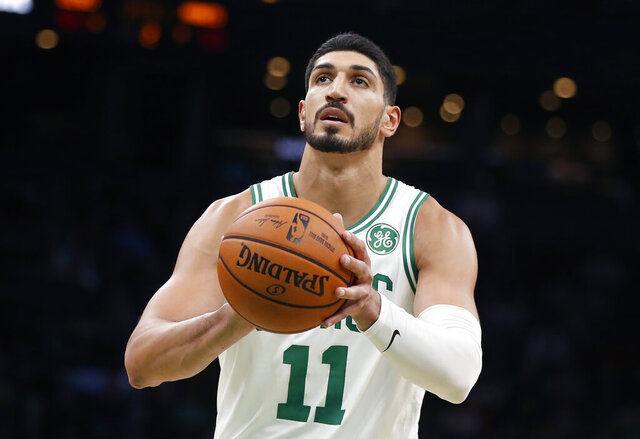 FILE - In this Sunday, Oct. 6, 2019 file photo, Boston Celtics' Enes Kanter plays against the Charlotte Hornets during the first half of a preseason NBA basketball game in Boston. Former Oklahoma City Thunder player Enes Kanter plans to open a charter school in the city. Kanter, who now plays for the Boston Celtics, has told Oklahoma City Public Schools of his plan to open the Enes Kanter School for Exceptional Learning. (AP Photo/Michael Dwyer)