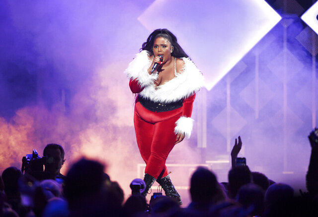 FILE - In this Dec. 13, 2019 file photo, singer Lizzo performs at Z100's iHeartRadio Jingle Ball 2019 at Madison Square Garden, in New York. After dominating 2019, the singer-rapper will headline the Bonnaroo Music and Arts Festival this June, alongside rockers Tool and Tame Impala. The four-day music festival to be held June 11-14 in Manchester, Tennessee, announced the lineup Tuesday, Jan. 7, 2020, for its 19th year. (Photo by Evan Agostini/Invision/AP, File)