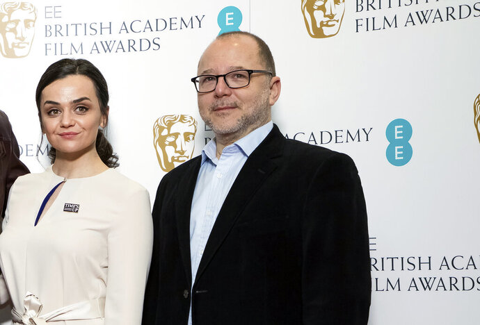 "FILE - In this Wednesday, Jan. 9, 2019 file photo, BAFTA Chair of the Film Committee Marc Samuelson poses for photographers next to actor Hayley Squires in London. The British Academy of Film and Television Arts promised to change after nominations for the 2020 awards were announced last January. No women were nominated as best director for the seventh year running, and all 20 nominees in the lead and supporting performer categories were white. ""We said on the day, 'We're going to review everything,'"" BAFTA film committee chairman Marc Samuelson said Thursday, Sept. 24. 2020 as the academy announced a slate of changes.  (Photo by Vianney Le Caer/Invision/AP, file)"