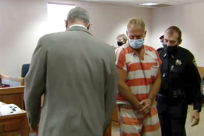 In this still image from video, Barry Morphew, center, appears in court in Salida, Colo., Thursday, May 6, 2021. Morphew was arrested on Wednesday, May 5, in connection with the disappearance of his wife, Suzanne Morphew, who was last seen a year ago on Mother's Day, May 10, 2020. (KUSA via AP, Pool)