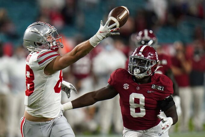 Ohio State tight end Jeremy Ruckert catches a pass in front of Alabama linebacker Christian Harris during the first half of an NCAA College Football Playoff national championship game, Monday, Jan. 11, 2021, in Miami Gardens, Fla.. (AP Photo/Chris O'Meara)