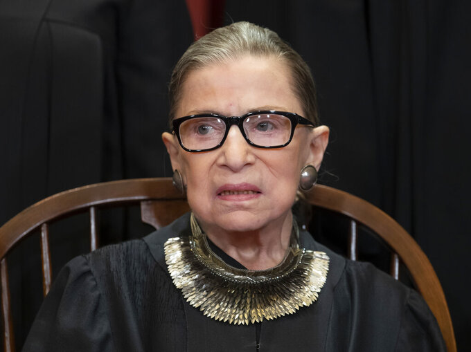 FILE - In this Nov. 30, 2018 file photo, Associate Justice Ruth Bader Ginsburg, nominated by President Bill Clinton, sits with fellow Supreme Court justices for a group portrait at the Supreme Court Building in Washington, Friday. The Supreme Court says Ginsburg has died of metastatic pancreatic cancer at age 87. (AP Photo/J. Scott Applewhite, File)