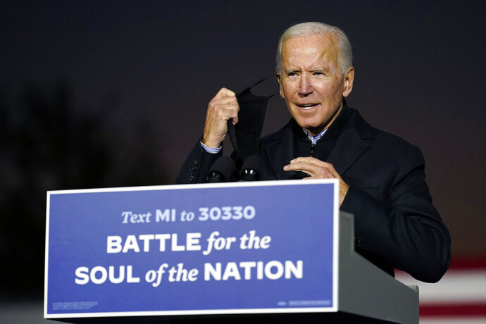 Democratic presidential candidate former Vice President Joe Biden arrives to speak at a rally at Belle Isle Casino in Detroit, Mich., Saturday, Oct. 31, 2020, which former President Barack Obama also attended. (AP Photo/Andrew Harnik)