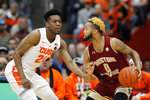 Boston College's Ky Bowman, right, dribbles against Syracuse's Tyus Battle, left, during the first half of an NCAA college basketball game in Syracuse, N.Y., Saturday, Feb. 9, 2019. (AP Photo/Nick Lisi)
