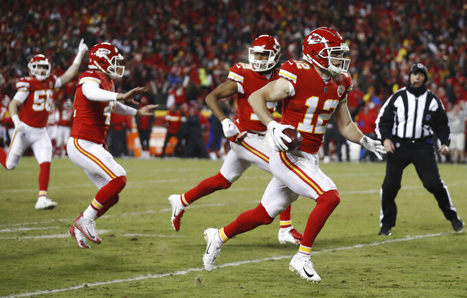 Kansas City Chiefs' Gehrig Dieter (12) runs after picking up a mishandled punt by New England Patriots during the second half of the AFC Championship NFL football game, Sunday, Jan. 20, 2019, in Kansas City, Mo. The play was called back after the review. (AP Photo/Jeff Roberson)
