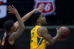 Baylor's Jared Butler (12) shoots under pressure from Oklahoma State's Avery Anderson III during the second half of an NCAA college basketball game in the semifinals of the Big 12 tournament in Kansas City, Mo., Friday, March 12, 2021. (AP Photo/Charlie Riedel)