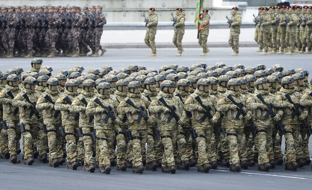 Azerbaijani troops march past during a parade in Baku, Azerbaijan, Thursday, Dec. 10, 2020. A military parade has been held in the Azerbaijani capital in celebration of a peace deal with Armenia over Nagorno-Karabakh that saw Azerbaijan reclaim much of the separatist region along with surrounding areas.  (AP Photo)