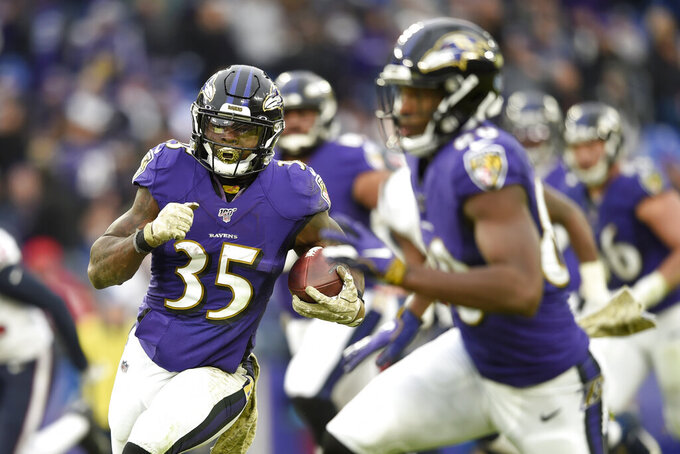 Baltimore Ravens running back Gus Edwards runs for a touchdown against the Houston Texans during the second half of an NFL football game, Sunday, Nov. 17, 2019, in Baltimore. (AP Photo/Gail Burton)