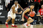 Cincinnati guard Keith Williams (2) steals the ball from Houston guard Quentin Grimes (24) in the second half of an NCAA college basketball game, Saturday, Feb. 1, 2020, in Cincinnati. (Kareem Elgazzar/The Cincinnati Enquirer via AP)