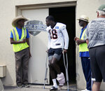 Cincinnati Bengals wide receiver A.J. Green (18) leaves practice early with an injury to his left ankle area during NFL football training camp at Welcome Stadium in Dayton, Ohio, on Saturday, July 27, 2019. (Sam Greene/The Cincinnati Enquirer via AP)