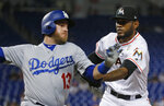 Miami Marlins relief pitcher Tayron Guerrero, right, tags out Los Angeles Dodgers' Max Muncy as he heads for first base during the seventh inning of a baseball game Tuesday, May 15, 2018, in Miami. The Marlins defeated the Dodgers 4-2. (AP Photo/Wilfredo Lee)