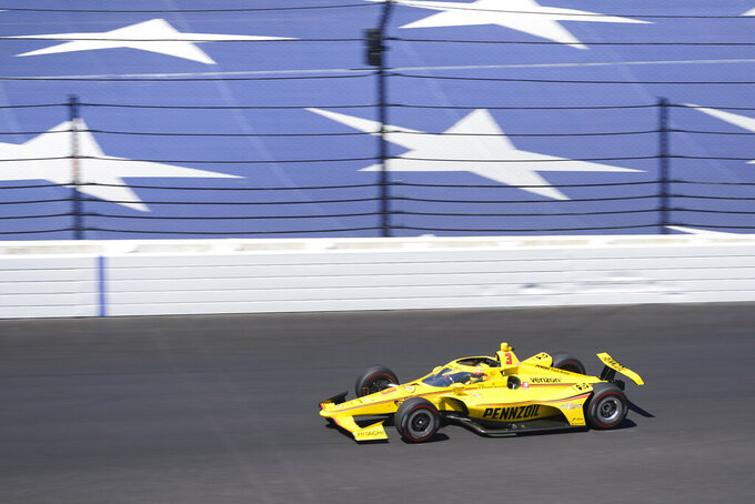 Helio Castroneves, of Brazil, drives into turn one during the final practice session for the Indianapolis 500 auto race at Indianapolis Motor Speedway, Friday, Aug. 21, 2020, in Indianapolis. (AP Photo/Darron Cummings)