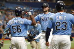 Tampa Bay Rays' Austin Meadows, center, celebrates with teammates Randy Arozaerena and Nelson Cruz after hitting a two-run home run against the Minnesota Twins during the fifth inning of a baseball game on Sunday, Sept. 5, 2021, in St. Petersburg, Fla. (AP Photo/Scott Audette)