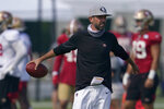 FILE - In this Aug. 22, 2020, file pool photo, San Francisco 49ers head coach Kyle Shanahan watches during NFL football practice in Santa Clara, Calif., Saturday, (AP Photo/Jeff Chiu, Pool, File