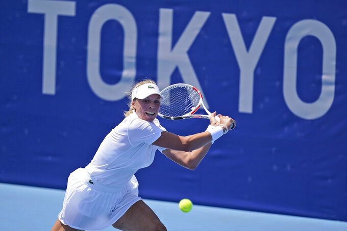 Anett Kontaveit, of Estonia, plays against Maria Sakkari, of Greece, during the first round of the tennis competition at the 2020 Summer Olympics, Saturday, July 24, 2021, in Tokyo, Japan. (AP Photo/Seth Wenig)
