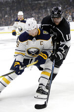 Buffalo Sabres' Jack Eichel, left, works against Los Angeles Kings' Anze Kopitar (11) during the second period of an NHL hockey game Thursday, Oct. 17, 2019, in Los Angeles. (AP Photo/Marcio Jose Sanchez)