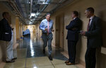 Sen. Joe Manchin, D-W.Va., one of the key Senate infrastructure negotiators, rushes back to a basement room at the Capitol as he and other Democrats work behind closed doors, in Washington, Wednesday, June 16, 2021. (AP Photo/J. Scott Applewhite)