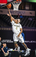Wake Forest guard Daivien Williamson (4) shoots under defense from Georgia Tech guard Jose Alvarado during an NCAA college basketball game Friday, March 5, 2021, in Winston-Salem, N.C. (Andrew Dye/The Winston-Salem Journal via AP)