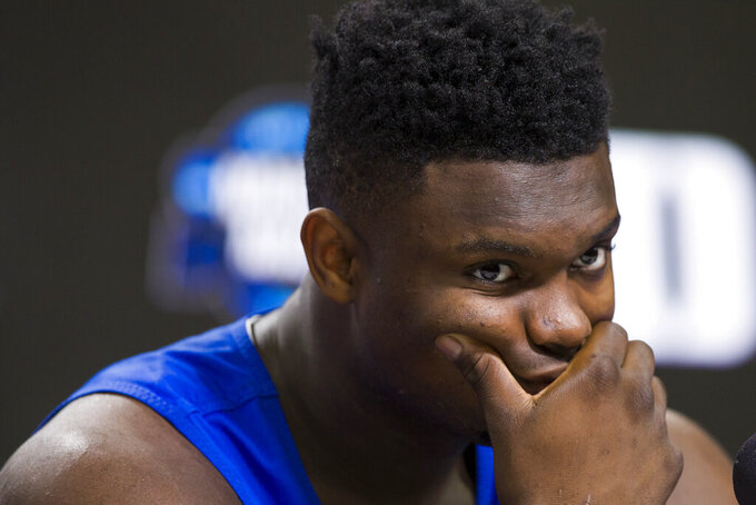 Duke forward Zion Williamson listens during an NCAA men's college basketball news conference in Washington, Saturday, March 30, 2019. Duke plays Michigan State in the East Regional final game on Sunday.(AP Photo/Alex Brandon)