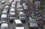 Vehicles are caught in a congestion as the flow of traffic of the capital significantly increases during a rush hour in Jakarta, Indonesia, Monday, June 8, 2020. Indonesia's capital of Jakarta, the city hardest hit by the new coronavirus, has partly reopened after two months of partial lockdown as the world's fourth most populous nation braces to gradually reopen its economy. (AP Photo/Achmad Ibrahim)