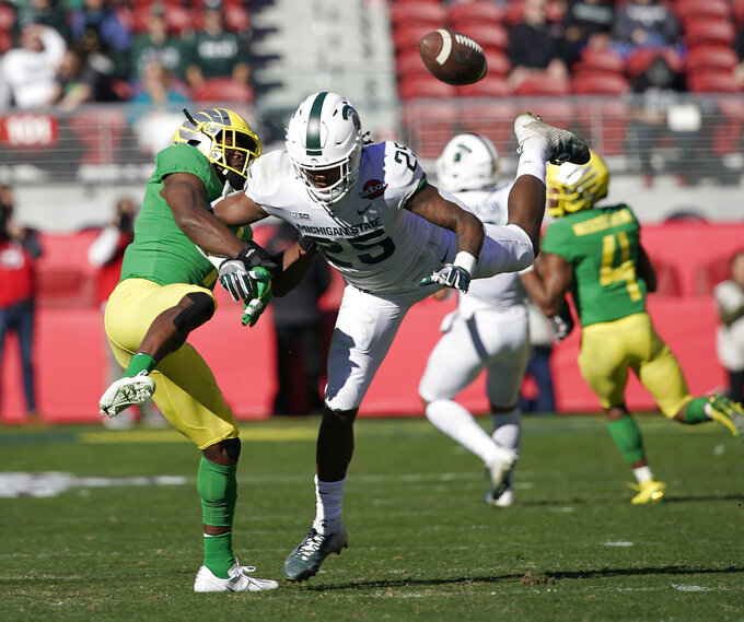 Oregon Ducks safety Ugochukwu Amadi (7) breaks up a pass for Michigan State Spartans wide receiver Darrell Stewart Jr. (25) during the first half of the Redbox Bowl NCAA college football game Monday, Dec. 31, 2018, in Santa Clara, Calif. (AP Photo/Tony Avelar)