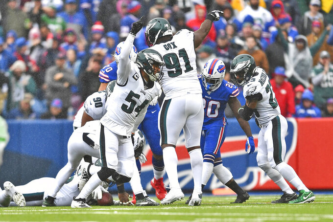 Philadelphia Eagles' Kamu Grugier-Hill (54), left, and other defenders celebrate recovering a fumble during the first half of an NFL football game against the Buffalo Bills, Sunday, Oct. 27, 2019, in Orchard Park, N.Y. (AP Photo/Adrian Kraus)