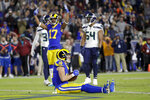 Los Angeles Rams wide receiver Cooper Kupp, bottom, celebrates after scoring during the first half of an NFL football game against the Seattle Seahawks Sunday, Dec. 8, 2019, in Los Angeles. (AP Photo/Marcio Jose Sanchez)