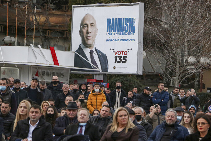 Supporters of Ramush Haradinaj, candidate for prime minister of the Alliance for the Future of Kosova (AAK), gather during a rally in the town of Peja, Kosovo, on Wednesday, Feb. 10, 2021. Kosovo holds an early general election on upcoming Sunday Feb. 14, amid the coronavirus pandemic, economic downturn and stalled negotiations with wartime foe Serbia. (AP Photo/Visar Kryeziu)