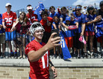 Buffalo Bills quarterback Josh Allen takes a selfie with fans after practice at the NFL football team's training camp in Pittsford, N.Y., Thursday, July 25, 2019. (AP Photo/Adrian Kraus)