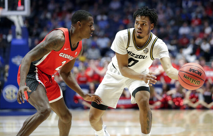 Missouri guard Torrence Watson (0) passes past Georgia guard Jordan Harris (2) in the second half of an NCAA college basketball game at the Southeastern Conference tournament, Wednesday, March 13, 2019, in Nashville, Tenn. Missouri won 71-61. (AP Photo/Mark Humphrey)