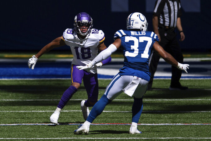Minnesota Vikings wide receiver Justin Jefferson (18)  runs a route against Indianapolis Colts safety Khari Willis (37) during an NFL football game Sunday, Sept. 20, 2020, in Indianapolis. Vikings rookie Justin Jefferson isn't used to losing, coming from LSU, but the first two games of his NFL career have been decisive defeats. The struggling Vikings need their first-round draft pick wide receiver to develop quickly in a season that's already on the brink. (AP Photo/Zach Bolinger)