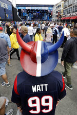 Houston Texans fan Eduardo Hernandez, of Del Rio, Texas, watches the activities on the stage during the final day of the NFL football draft Saturday, April 27, 2019, in Nashville, Tenn. (AP Photo/Mark Humphrey)