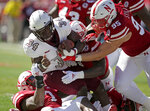 FILE- In this Oct. 27, 2018 file photo, Bethune-Cookman running back Isaac Washington (34) is tackled by Nebraska linebacker Mohamed Barry, left, linebacker Caleb Tannor (4) and defensive lineman Ben Stille (95) during the first half of an NCAA college football game in Lincoln, Neb. The Nebraska defense is counting on Stille and his linemates as the 24th-ranked Cornhuskers try to rebound from a 4-8 record last year. (AP Photo/Nati Harnik, File)