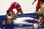 Notre Dame's Juwan Durham, left, grabs a loose ball next to Ohio State's E.J. Liddell during the first half of an NCAA college basketball game Tuesday, Dec. 8, 2020, in South Bend, Ind. (AP Photo/Robert Franklin)