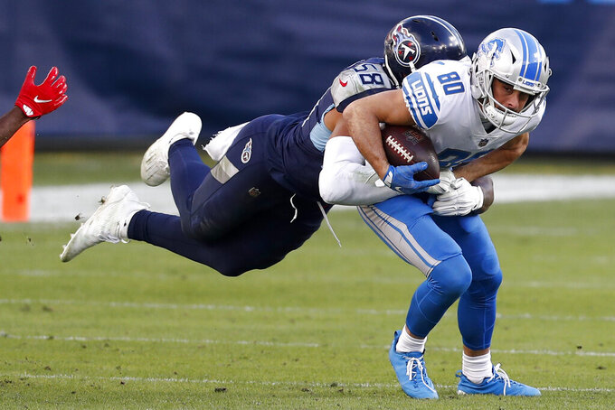 Detroit Lions wide receiver Danny Amendola is tackled by Tennessee Titans outside linebacker Harold Landry during the second half of an NFL football game Sunday, Dec. 20, 2020, in Nashville, N.C. (AP Photo/Wade Payne)