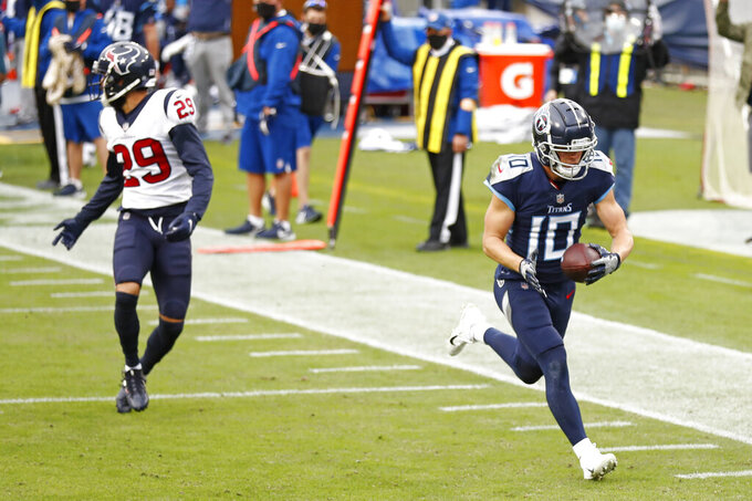 Tennessee Titans wide receiver Adam Humphries (10) catches a touchdown pass ahead of Houston Texans cornerback Phillip Gaines (29) in the first half of an NFL football game Sunday, Oct. 18, 2020, in Nashville, Tenn. (AP Photo/Wade Payne)