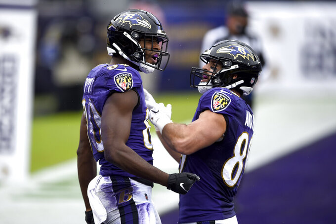 Baltimore Ravens wide receiver Miles Boykin, left, celebrates his touchdown reception with tight end Mark Andrews during the first half of an NFL football game against the Pittsburgh Steelers, Sunday, Nov. 1, 2020, in Baltimore. (AP Photo/Gail Burton)