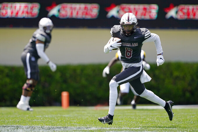 Alabama A&M wide receiver Zabrian Moore (8) takes a pass reception upfield against Arkansas-Pine Bluff during the first half of the Southwestern Athletic Conference NCAA college football game, Saturday, May 1, 2021, in Jackson, Miss. (AP Photo/Rogelio V. Solis)