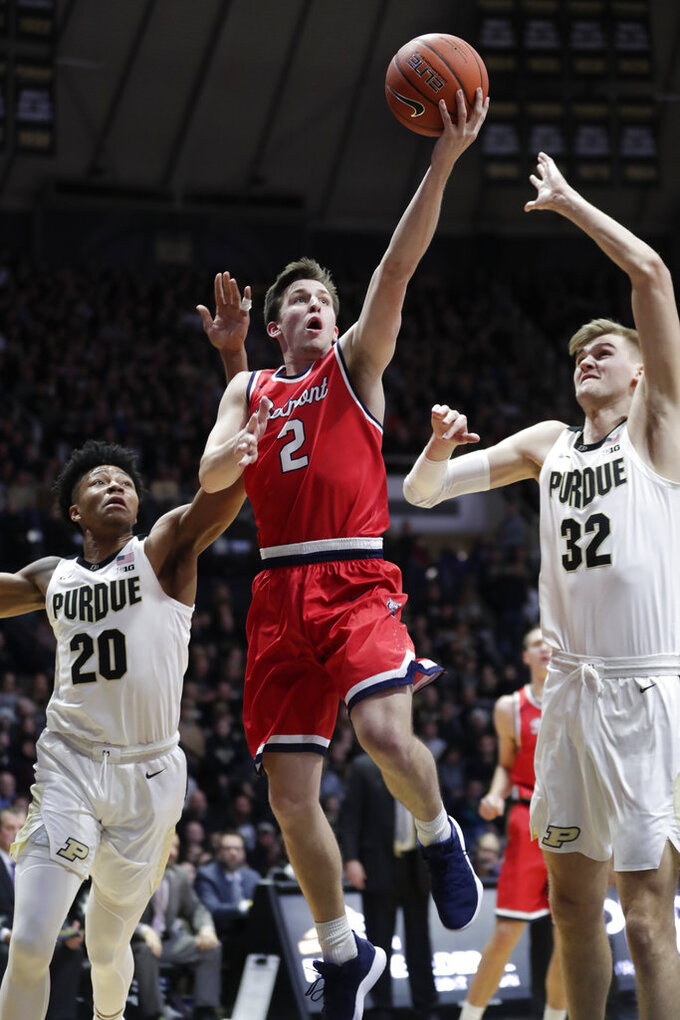 Belmont guard Grayson Murphy (2) shoots between Purdue guard Nojel Eastern (20) and center Matt Haarms (32) during the first half of an NCAA college basketball game in West Lafayette, Ind., Saturday, Dec. 29, 2018. (AP Photo/Michael Conroy)