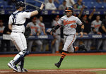 Baltimore Orioles' Mason Williams (40) scores ahead of the throw to Tampa Bay Rays catcher Mike Zunino (10) on a double by Mark Trumbo during the ninth inning of the first baseball game of a doubleheader Tuesday, Sept. 3, 2019, in St. Petersburg, Fla. The Orioles won 4-2, (AP Photo/Chris O'Meara)
