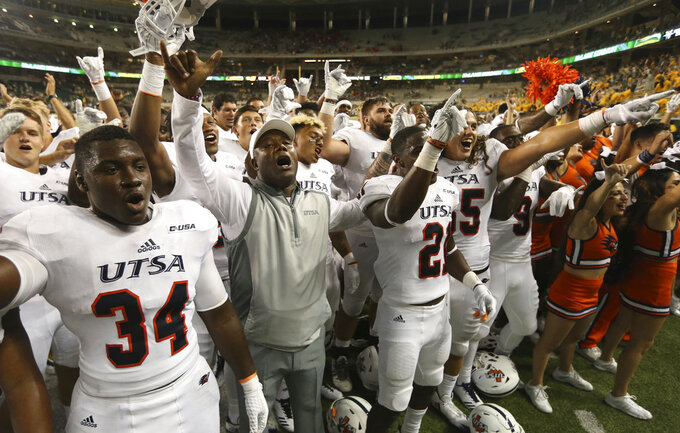 "FILE - In this Sept. 9, 2017, file photo, UTSA coach Frank Wilson, center, celebrates with his players following their 17-10 win over Baylor in an NCAA college football game, in Waco, Texas. Baylor coach Matt Rhule quickly made one thing clear about what happened early last season in a home loss to UTSA.  ""They were the tougher team last year, they were the tougher coaching staff last year, and they came in here and they were physical,"" Rhule said this week. (Rod Aydelotte/Waco Tribune Herald, via AP)"