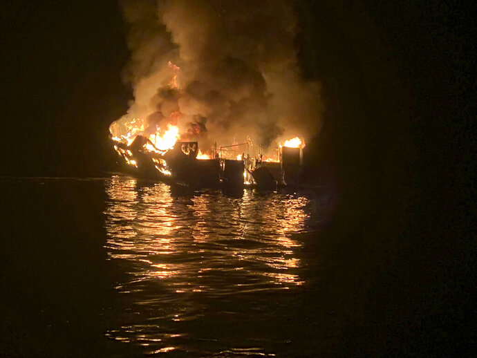 FILE - In this Sept. 2, 2019, file photo, provided by the Santa Barbara County Fire Department, a dive boat is engulfed in flames after a deadly fire broke out aboard the commercial scuba diving vessel off the Southern California Coast. The owners of the dive boat where 34 people perished in a fire off the coast of Southern California filed a legal action in federal court Thursday, Sept. 5, 2019, to head off potentially costly lawsuits. Truth Aquatics Inc., which owned the Conception, filed the action in Los Angeles under a pre-Civil War provision of maritime law that allows it to limit its liability. (Santa Barbara County Fire Department via AP, File)