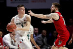 Miami guard Dejan Vasiljevic (1) looks to pass as North Carolina State guard Braxton Beverly (10) defends during the first half of an NCAA college basketball game, Wednesday, Feb. 5, 2020, in Coral Gables, Fla. (AP Photo/Lynne Sladky)